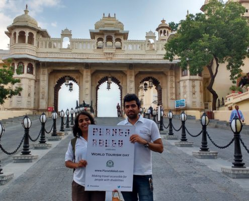 Neha Arora holding a banner of Planet Abled on World tourism Day at Udaipur