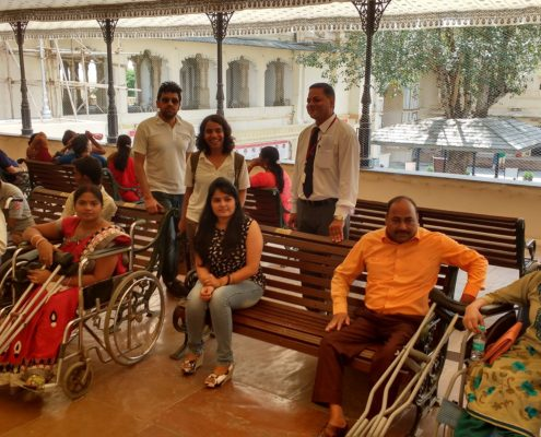People with disabilities sitting in Udaipur City Palace