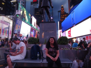 Shivangi sitting in the Times Square