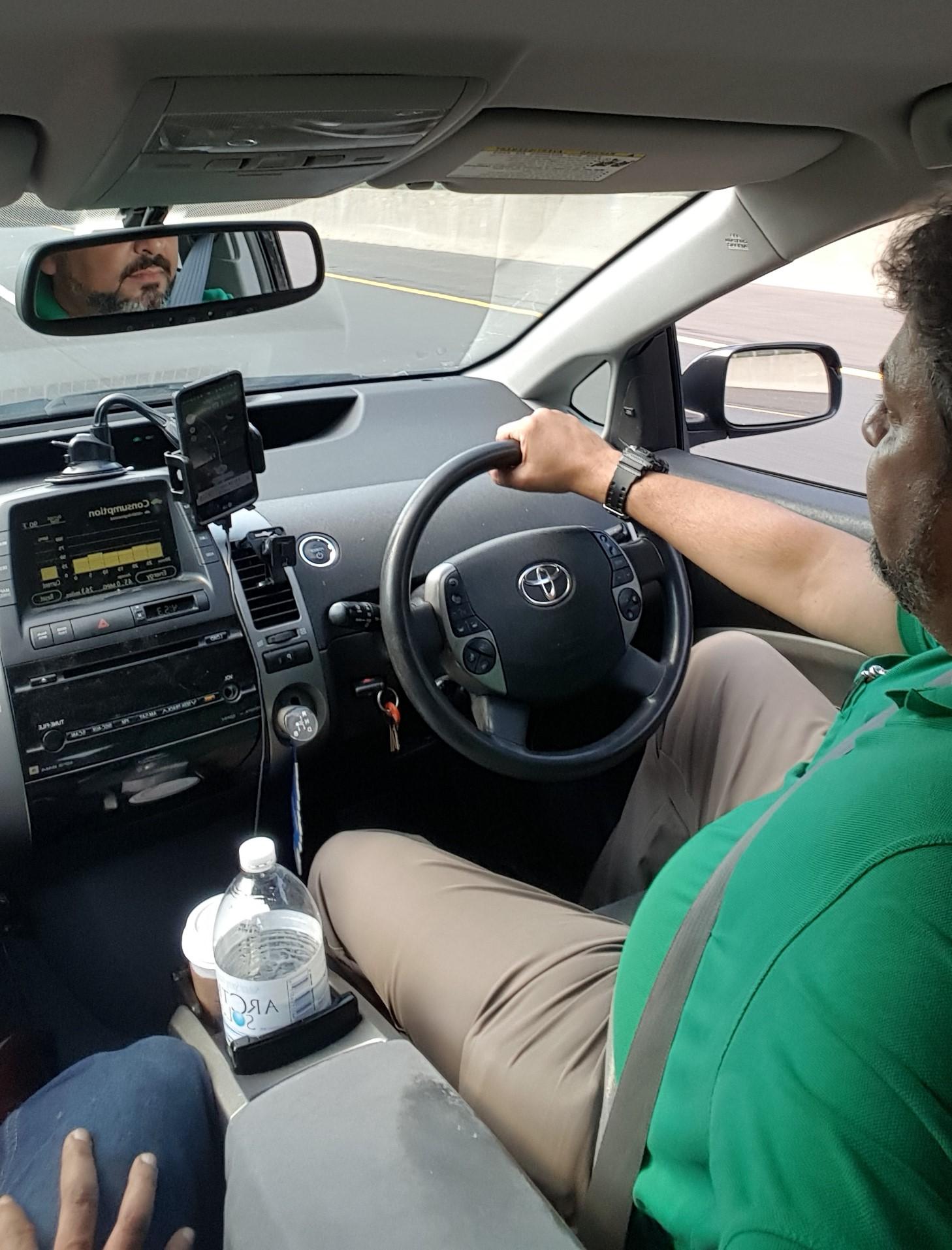 Zorin driving his car in a roadtrip