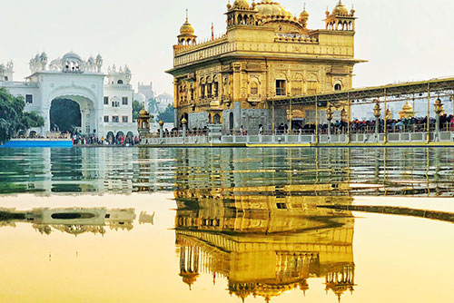 A picture of the Golden temple along with its reflection in water