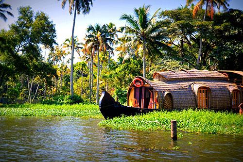 A houseboat moving through Kerala backwaters